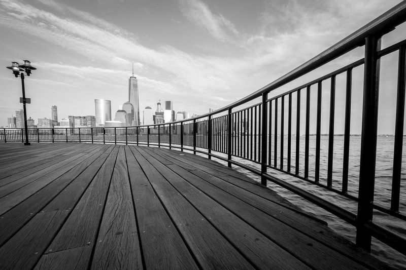 Promenade By Hudson River Against One World Trade Center In City