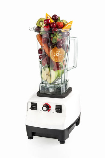 Blender with fruits berries and vegetable, Blender smoothie made of healthy fruits. Appliance Berry Fruit Blender Carrot Cut Out Dieting Electric Mixer Food Food And Drink Freshness Fruit Healthy Eating Household Equipment Indoors  Kiwi No People Orange Smooties Still Life Strawberry Studio Shot Transparent Vegetable Wellbeing White Background