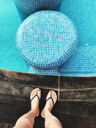 Low Section Of Woman Standing On Poolside