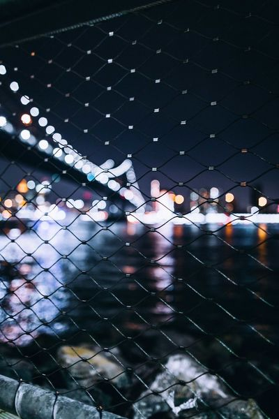 NYC Architecture Check This Out Colors Exploring EyeEm EyeEm Best Shots Lights New York City Nightphotography Reflection Backgrounds Bokeh Bridge Explore Fence Focus On Foreground Illuminated Night No People Outdoors River Street Streetphotography Travel Destinations Urban