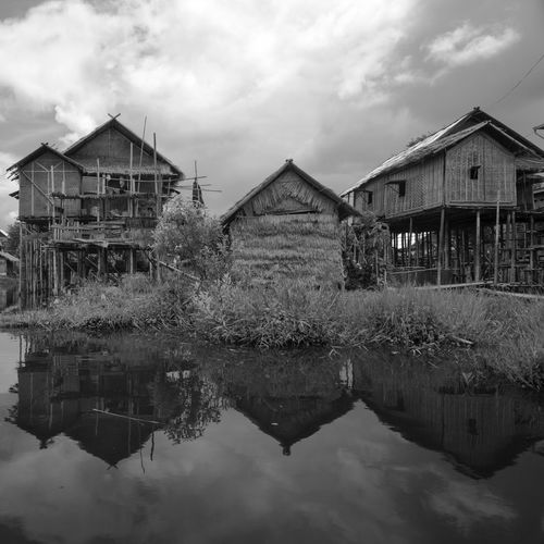 Bambou houses. Inle lac. Reflection Water House Waterfront Canal Outdoors Symmetry Riverbank Atmospheric Mood Travel Lake Monochrome Photography Atmosphere