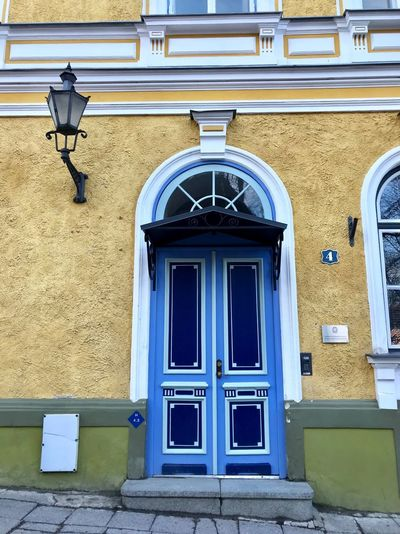 Door ShotOnIphone Architecture Estonia Tallinn Tallinn Old Town Tallinn Estonia Baltic Countries Colorful Built Structure Architecture Building Exterior Building Window Door No People Arch Safety Lighting Equipment Residential District Wall - Building Feature Outdoors Entrance Wall Security Day Closed Protection Street