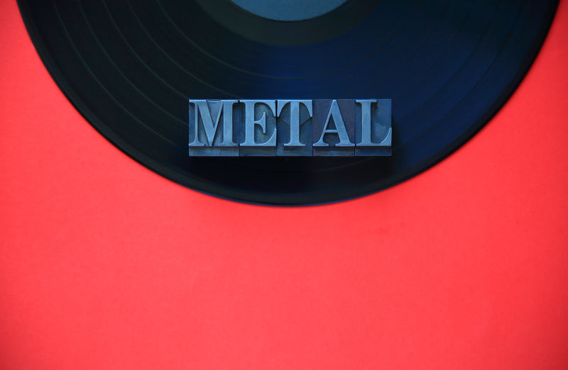 Metal word on vinyl record Black Close-up Communication Day Entertainment Font Gray Indoors  Letters Metal Metal Type Minimal Music Category No People Red Semicircle Simple Composition Text Text Space Typeface  Typography Vinyl Record Word