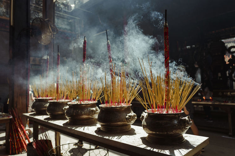 Shot at Thien Hau Temple, Saigon, Vietnam. Architecture Ash Built Structure Burning Cultures Day Flame Heat - Temperature Hope Incense Indoors  Large Group Of Objects No People Place Of Worship Religion Scented Smoke - Physical Structure Smoking - Activity Spirituality