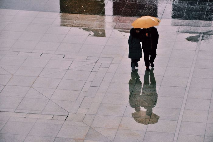 // the yellow umbrella // Weather Real People Rain Rainy Season Reflection One Person Lifestyles Protection Leisure Activity Standing Full Length Men Outdoors Day Low Section Nature