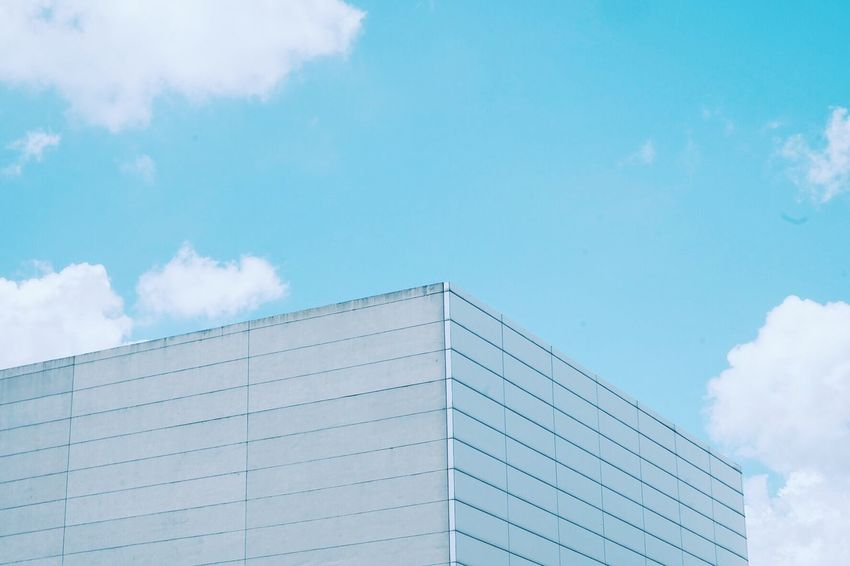 Eyem Vision Architecture Built Structure Low Angle View Blue Building Exterior Sky City Day Modern Office Building Outdoors Repetition City Life Cloud - Sky Development High Section No People Building Story