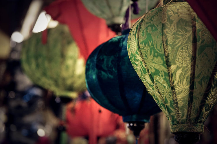Close-up of lanterns hanging outdoors
