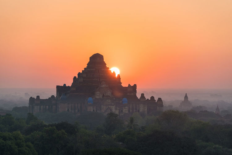 Temple against sky during sunset