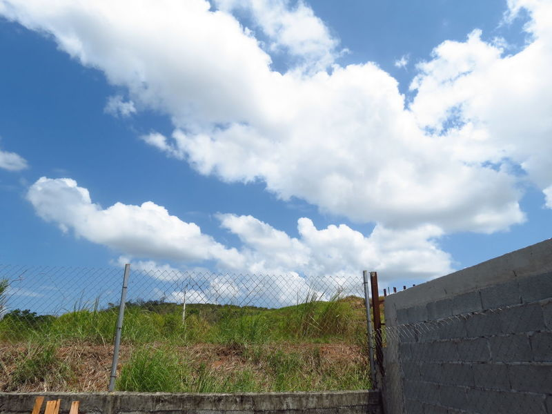 Boundary Cloud - Sky Day Fence Landscape Nature No People Outdoors Picket Fence Protection Renewable Energy Sky The Secret Spaces