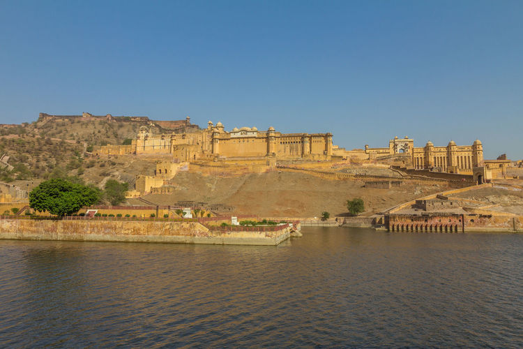 Amber fort in Jaipur Jaipur Jaipur Rajasthan Amber Fort Amer Fort Water Architecture Built Structure Sky Building Exterior Clear Sky Waterfront History Nature The Past Copy Space Day No People Travel Travel Destinations Tourism Blue Building Outdoors