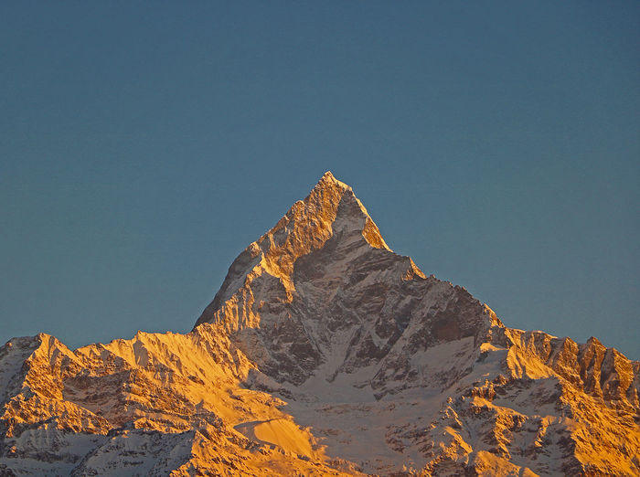Low angle view of machapuchare mountain against sky