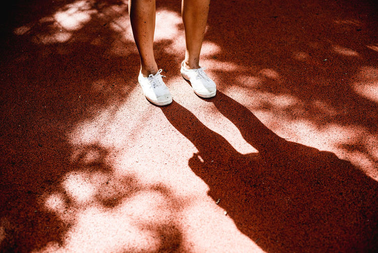 Human Foot Legs Leisure Activity Lifestyles Light Light And Shadow Person Tennis Court