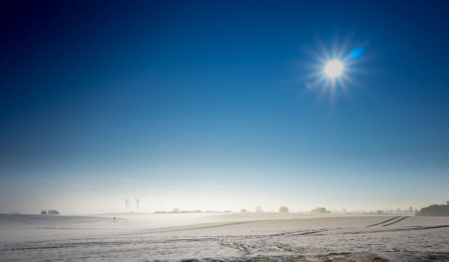 Sky Environment Scenics - Nature Landscape Sun Nature Blue Lens Flare Land Tranquil Scene Winter Sunlight Tranquility Clear Sky Desert Beauty In Nature Snow Cold Temperature No People Outdoors Climate Arid Climate Bright