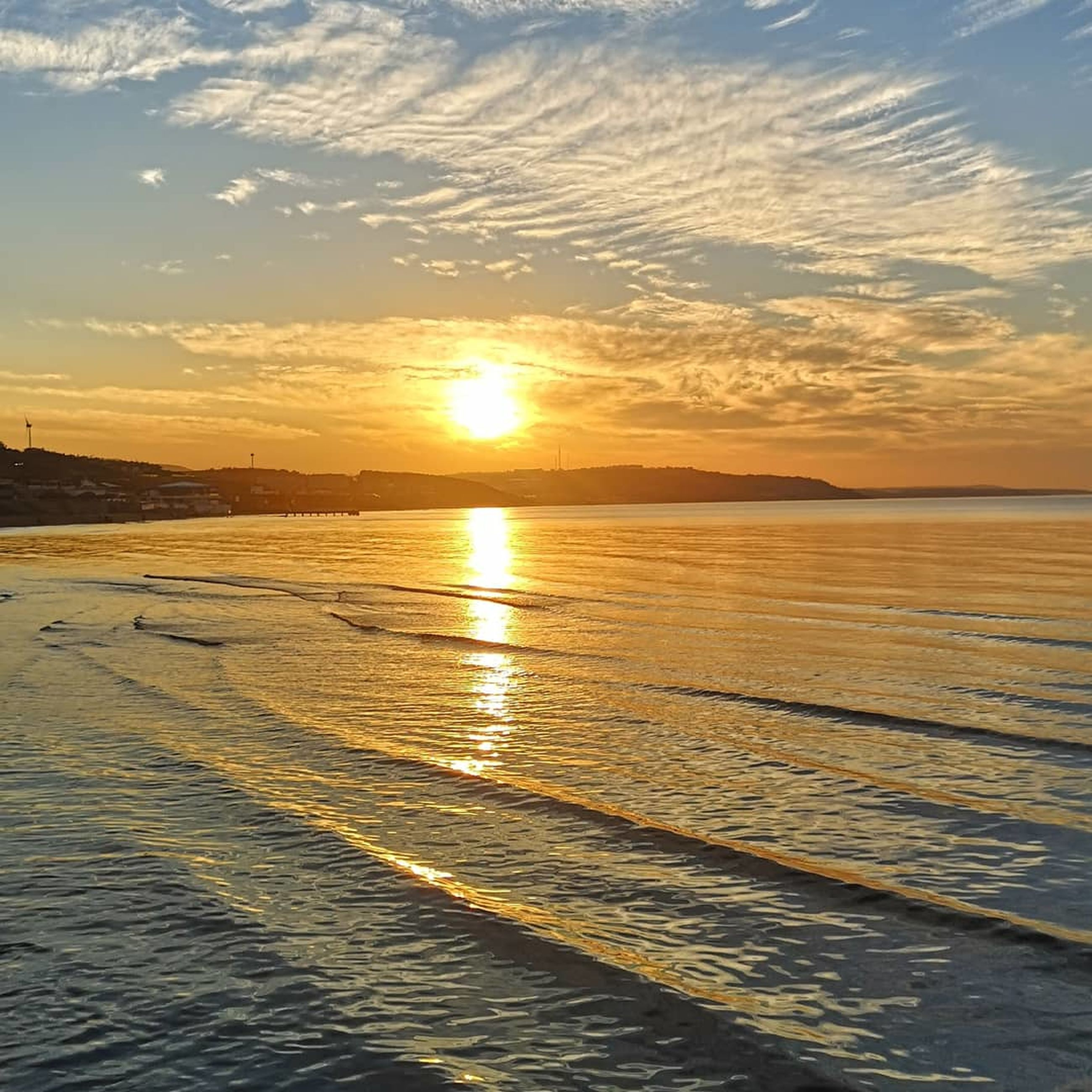 sunset, sky, water, scenics - nature, sea, beauty in nature, tranquility, cloud - sky, tranquil scene, horizon, horizon over water, orange color, idyllic, nature, land, sun, beach, sunlight, no people, outdoors
