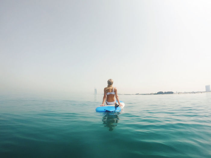 Woman sitting on the paddle board with a view on burj al arab