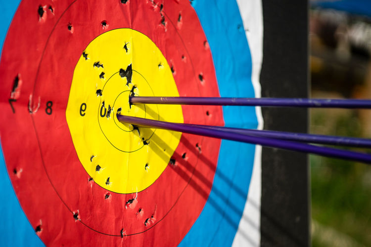 Close-up No People Blue Sports Target Yellow Focus On Foreground Sport Accuracy Day Arrow - Bow And Arrow Circle Multi Colored Target Shooting Outdoors Geometric Shape Metal Red Midsection Number Archery
