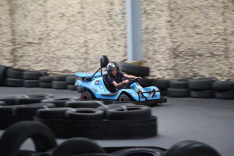 Teenage boy driving go-cart