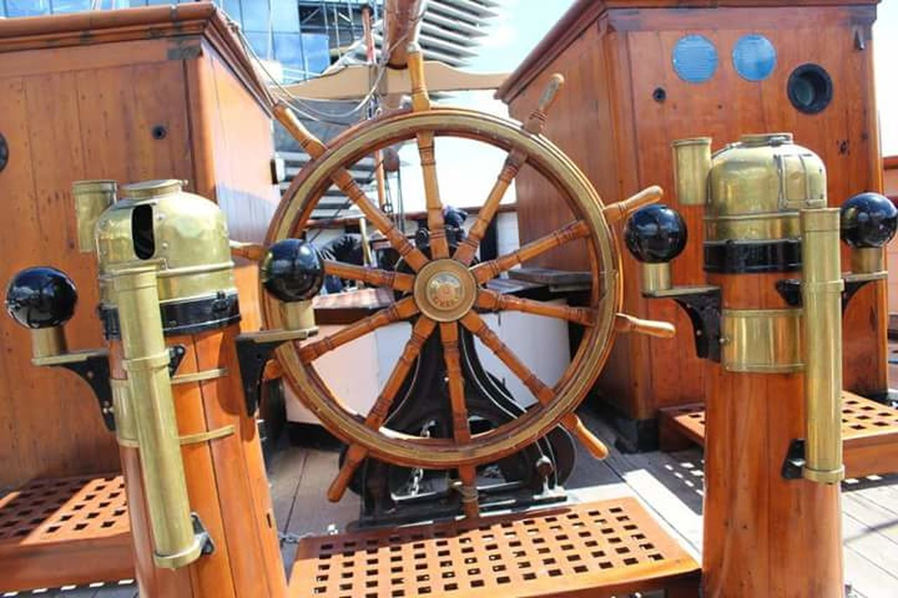 helm, control, mode of transport, nautical vessel, wheel, steering wheel, wood - material, transportation, yacht, direction, sailing, old-fashioned, sailing ship, navigational compass, boat deck, day, yachting, no people, close-up, outdoors