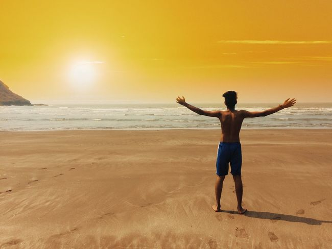 Real People Lifestyles Sea Beach Healthy Lifestyle Sunset Rear View Leisure Activity Arms Outstretched Beauty In Nature Men Nature One Person Exercising Scenics Full Length Sky Horizon Over Water Outdoors Water EyeEm Best Shots EyeEm Best Shots - Nature
