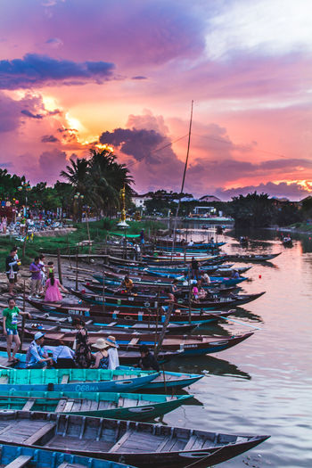 River boats lined up perfectly for the sunseet. ASIA Colors Hoi An Sky And Clouds Travel Travel Photography Vietnam Boats Clouds And Sky Colorful Sky Photography River Travel Destinations Water