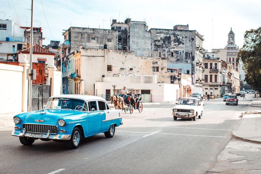 Typical street sight in Havana Architecture Building Exterior Built Structure Car City Cuba Day Havana Land Vehicle Large Group Of People Men Mode Of Transport Muscle Car Outdoors People Real People Road Sky Street Transportation