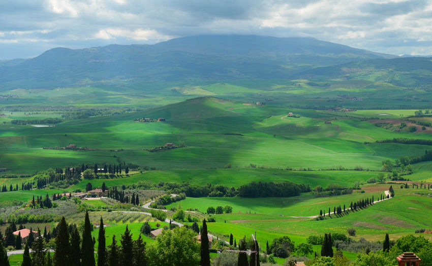 panorama of the Tuscan landscape Beauty In Nature Cloud - Sky Countryside Cultivated Land Grassy Green Color Landscape Landscape_Collection Landscapes Mountain Range Nature Rural Scene The Great Outdoors With Adobe