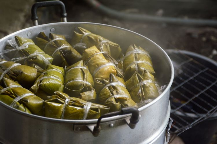 Thai style banana leaves wrapped food made from sticky rice on pot Banana Coconut Milk Dessert Hot Steam Stove Thailand Close-up Day Delicious Food Food And Drink Freshness Handmade Healthy Eating High Angle View Indoors  Leaf No People Pot River Sticky Rice Sweet Thailand Food Wrapped