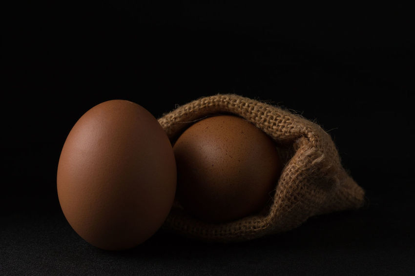 Animal Egg Black Background Breakfast Brown Close-up Cracked Dairy Product Egg Egg Carton Egg Yolk Eggcup Eggshell Food Food And Drink Fragility Freshness Healthy Eating Indoors  No People Protein Raw Food Ready-to-eat Studio Shot