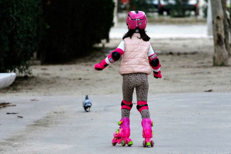 Practice makes perfect girl skate Girl Power Girl Skate Warm Clothing Child Childhood Full Length Girls City Pink Color Headwear Moments Of Happiness