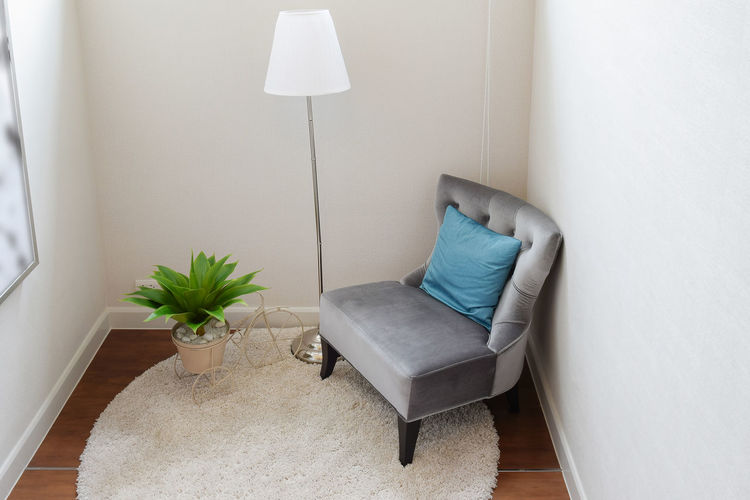 luxury grey tweed sofa with blue pillow in living corner at home Absence Chair Clean Comfortable Cozy Cushion Domestic Room Electric Lamp Flooring Furniture Home Home Interior Home Showcase Interior Indoors  Lighting Equipment Luxury Modern Neat No People Pillow Plant Seat Side Table Sofa Stuffed