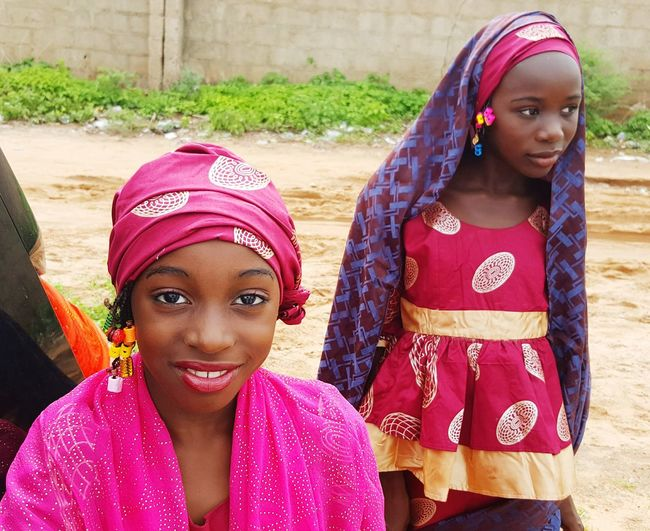 Child Red Childhood Girls Children Only Two People People Outdoors Smiling Rural Scene Day Colour Of Life Women Of Africa Africa Day To Day