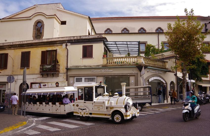 Holiday Holidays Travel Travel Photography Traveling Travelling Architecture Building Exterior Built Structure City Mode Of Transport Sorrento Sorrento, Italia Street Street Photography Streetphotography Tourist Train Touristic Train Travel Destinations Traveller Travelphotography
