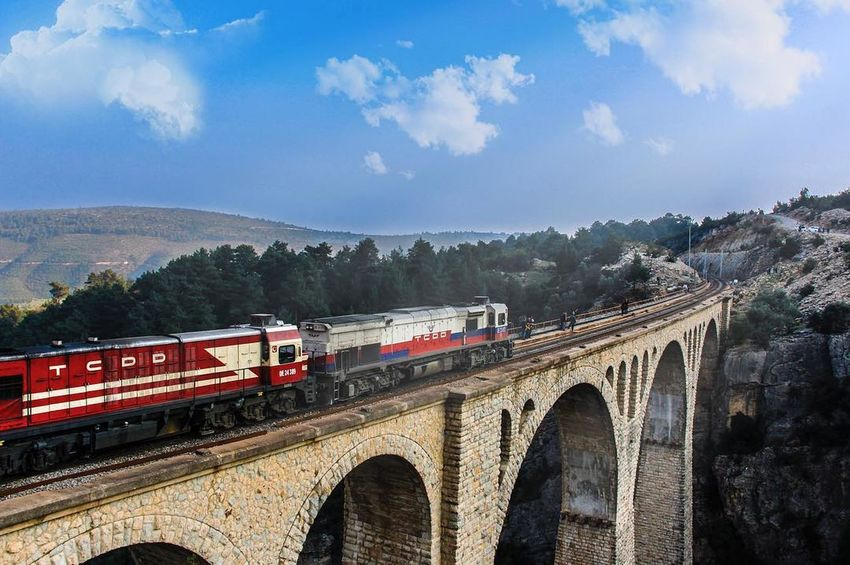 Arch Architecture Bridge - Man Made Structure Built Structure Cloud - Sky Commuter Train Connection Day Locomotive Mountain Nature No People Outdoors Sky Steam Train Train - Vehicle Transportation Tree