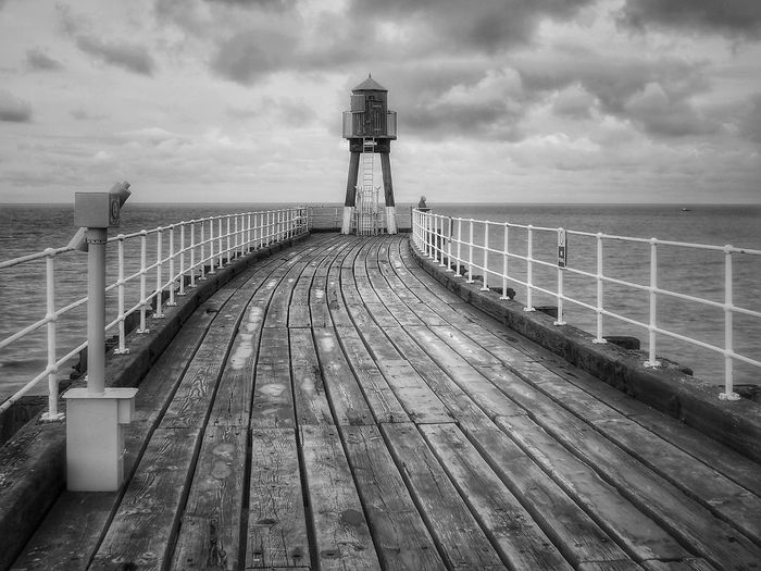 Whitby Pier Sea Cloud - Sky No People Vacations Travel Destinations Whitby Beach Sea Whitby North Yorkshire Waves, Ocean, Nature Creative Light And Shadow Color Photography The World Through My Eyes Creative Light And Shadow Malephotographerofthemonth Yorkshire Coast Whitby Pier North Yorkshire Coast Built Structure Back & White Monochrome Photography Bridge - Man Made Structure Architecturephotography Close-up Whitbypier Pier Photos Black And White Friday