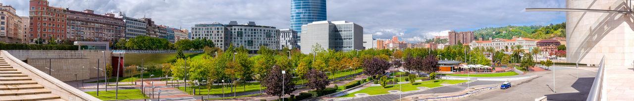 Panoramic shot of city buildings against sky