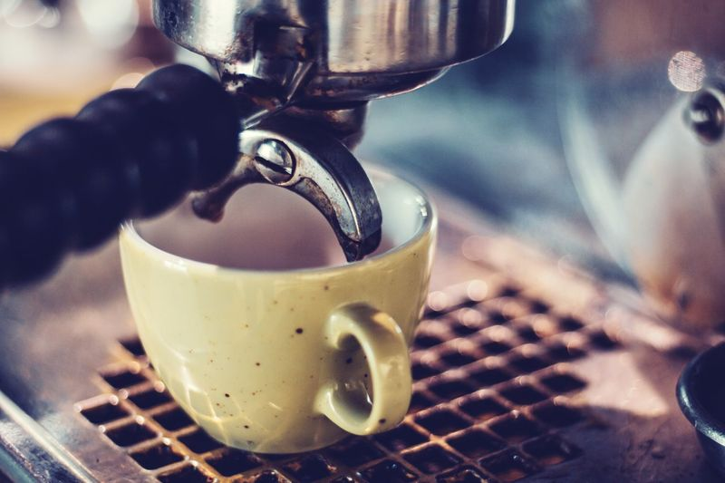 brewing coffee retro style Barista Vintage Style Retro Coffee Machine Coffee Drink Refreshment Food And Drink Coffee - Drink Cup Coffee Cup Mug Close-up Indoors  Pouring Focus On Foreground Coffee Maker No People Espresso Maker Preparation  Machinery Coffee Shop Espresso