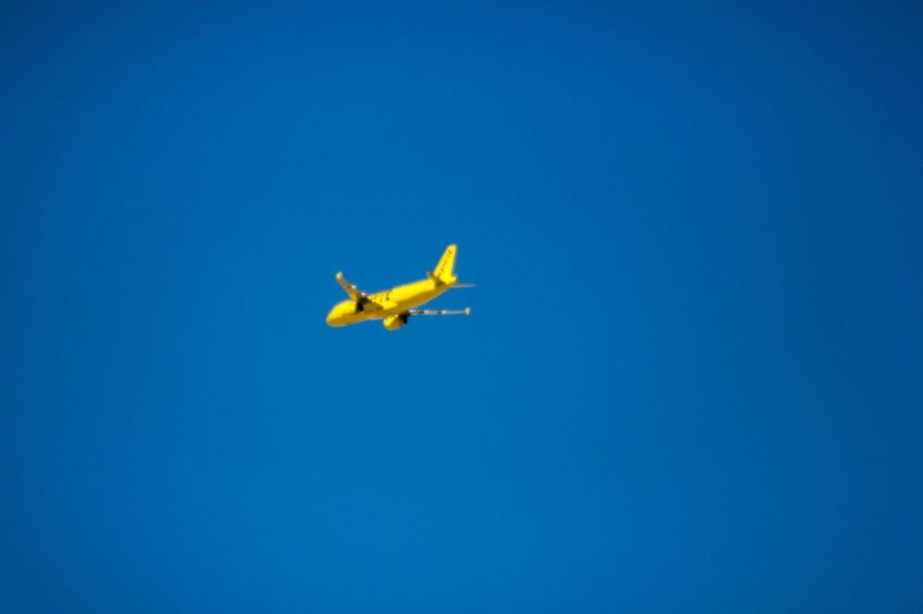 Clear Background Yellow Airplane Airplane In The Sky EyeEm Selects Blue Air Vehicle Flying Airplane Transportation Mode Of Transportation No People on the move Mid-air Motion Day Nature Travel Copy Space Clear Sky Low Angle View Journey Plane
