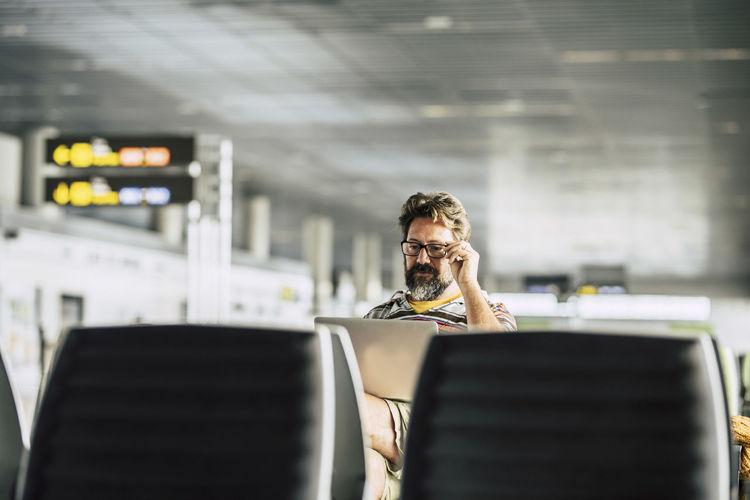 Man sitting at airport