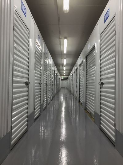 Indoors  The Way Forward No People Illuminated Architecture Locker Room Operating Room Day Vanishing Point White Metal Architecture Door Storage Corridor