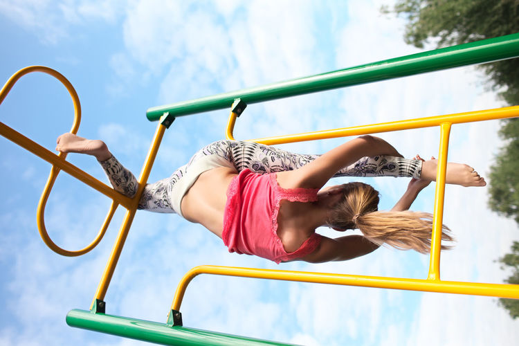Acrobatic Apparatus Athletic Caucasian Exercises  Girl Gymnastic Outdoors Outside Park Playful Playground Playing Plays Sky Sport Upside Woman Young Youthful