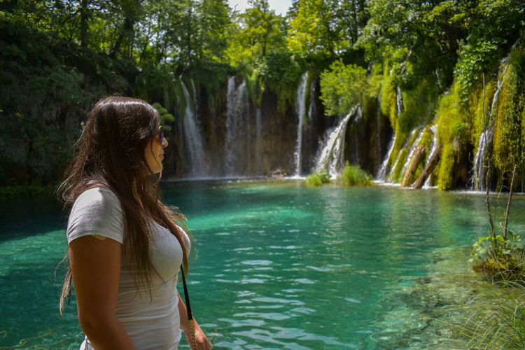 Plitvice Lake National Park Plitvice Lakes National Park Adult Beauty In Nature Forest Hair Hairstyle Leisure Activity Lifestyles Long Hair Nature One Person Outdoors Plant Plitvice Plitvice National Park Plitvickajezera Real People Standing Three Quarter Length Tree Water Women Young Adult