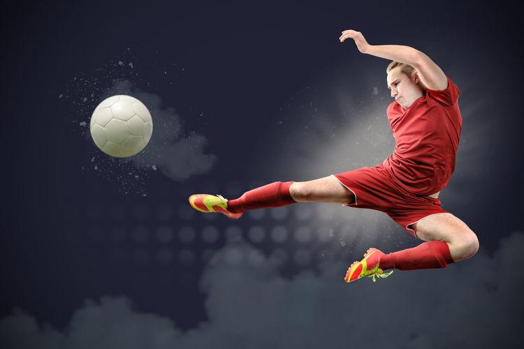 Man playing soccer in stadium