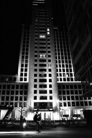 Lowlight Skateboarding Architecture Blackandwhite Building Exterior Built Structure City Low Angle View Modern Night Outdoors People Real People Skateboard Sport Youth Culture Discover Berlin