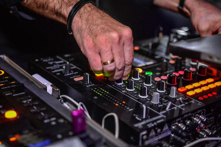 Hands adjusting regulators of a mixer unit