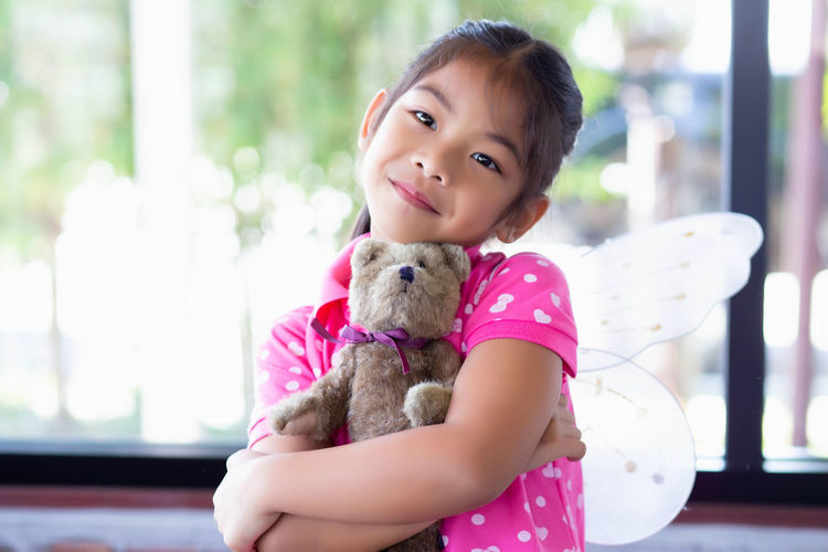 Portrait of cute girl with toy