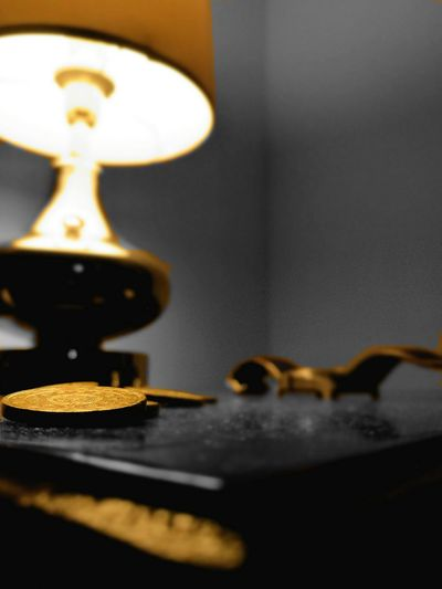 Pop Art Photos lines, shapes and curves Lowlightphotography Old-fashioned Indoors  Gold Colored Gold Coins On The Table Coins Close-up Wristwatch Wrist Watch Chandelier Light Popart Lazzy Pop Art Clumsygraphy Antique Clock Face Contrast Contrast And Lights Lights Table