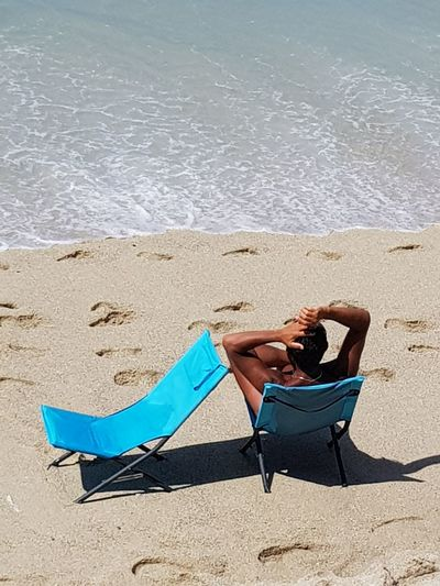 Beach Sand Relaxation Summer Lying Down Resting Sunbathing Vacations One Person Sea Leisure Activity Only Women Lying On Back Water Young Adult Adult Adults Only Young Women Beauty Full Length