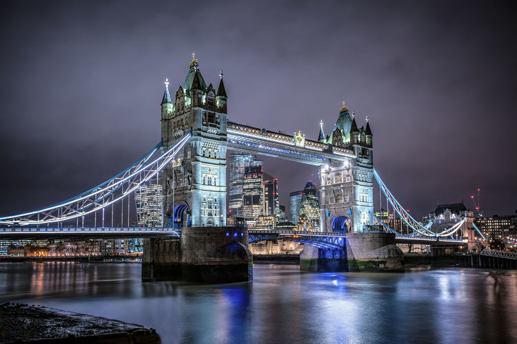 The Tower Bridge of London, UK, during night time Built Structure Architecture Connection Night Bridge City Water Travel Destinations Building Exterior River Illuminated Tourism Travel Waterfront Outdoors London Tower Bridge  Tourist Attraction  Landmark Gothic Architecture Thames River Lights City Of London Sightseeing Drawbridge