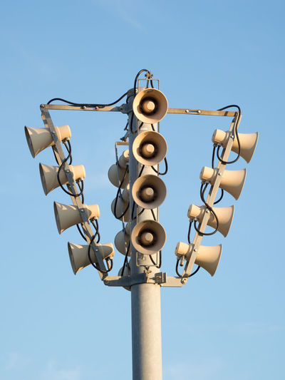 Low angle view of megaphones against clear sky