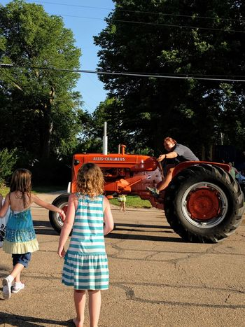 Old Settlers Picnic - Village of Western, Nebraska July 21, 2018 Allis Chalmers Americans Camera Work Community Event Farmer Getty Images Photo Essay Rural America Village Of Western, Nebraska Visual Journal Watching A Parade Allis Chalmers Antique Tractor Casual Clothing Child Childhood Day Eye4photography  Females Full Length Girls Group Of People Leisure Activity Long Form Storytelling Men My Neighborhood Nature Old Settlers Picnic Old Settlers Picnic 2018 Parade People Photo Diary Plant Real People Rear View S.ramos July 2018 Sibling Sister Small Town Stories Streetphotography Togetherness Transportation Tree Women The Street Photographer - 2018 EyeEm Awards